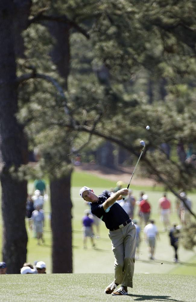 Jim Furyk hits off the third fairway during the first round of the Masters golf tournament Thursday, April 10, 2014, in Augusta, Ga