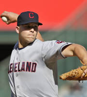 Cleveland Indians starting pitcher Justin Masterson throws against the Los Angeles Angels during the first inning of a baseball game Wednesday, Aug. 21, 2013, in Anaheim, Calif. (AP Photo/Jae C Hong)