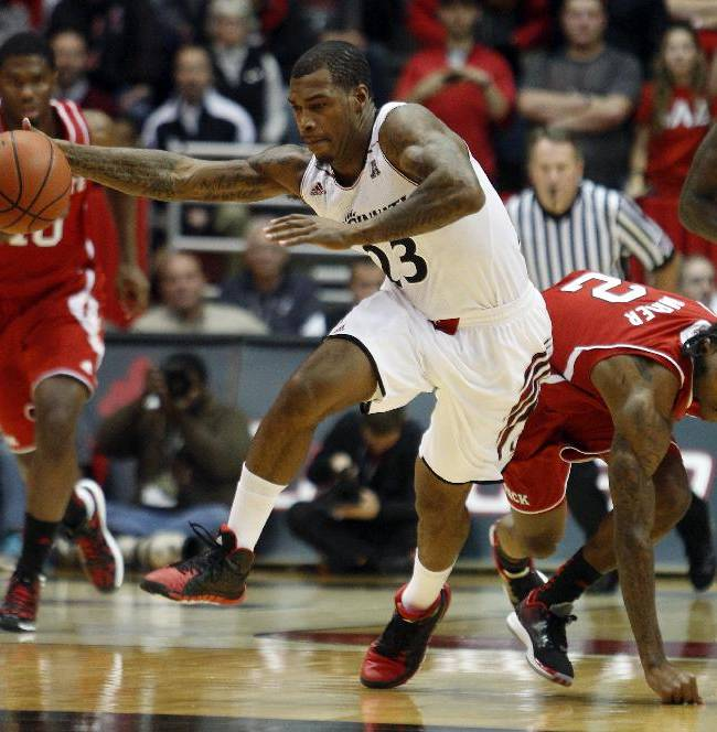 Cincinnati guard Sean Kilpatrick (23) gains control of the ball against North Carolina State guard Anthony Barber (2) during the first half of an NCAA college basketball game Tuesday, Nov. 12, 2013, in Cincinnati