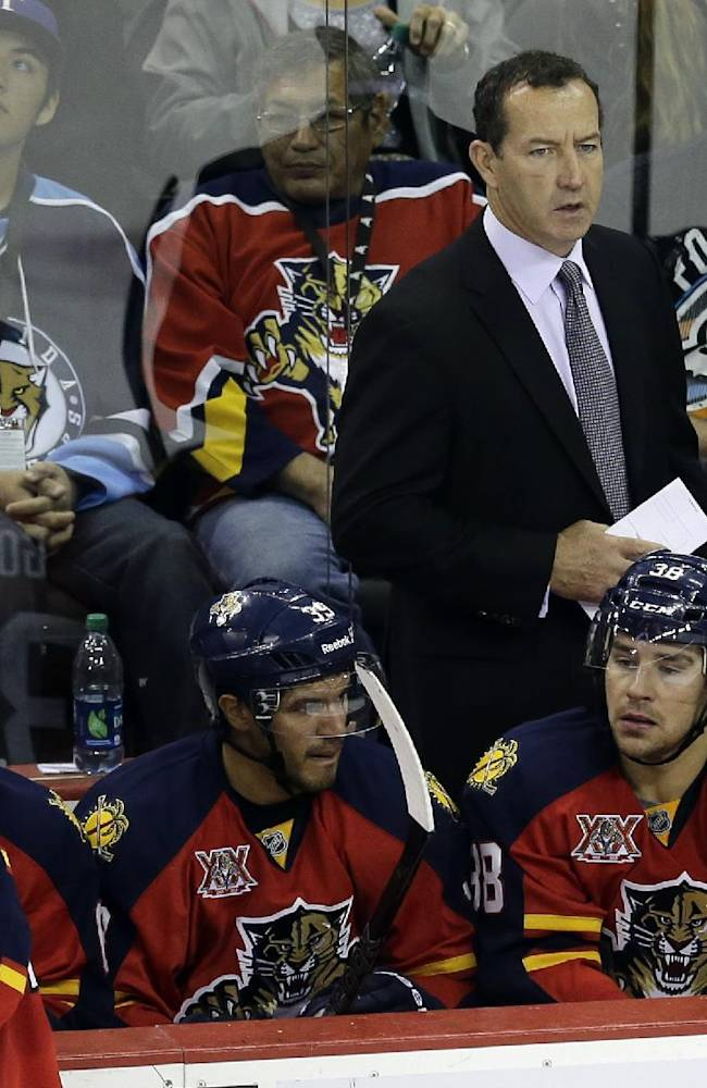 Florida Panthers coach Kevin Dineen, right, watches his team during the third period of a preseason NHL hockey game against the Dallas Stars, Friday,  Sept. 20, 2013, in San Antonio. Dallas won 4-1