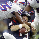Houston's Ryan Fitzpatrick (14) is sacked by Buffalo Bills' Jerry Hughes (55) during the first quarter of an NFL football game, Sunday, Sept. 28, 2014, in Houston. The Associated Press