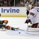 Arizona Coyotes goalie Louis Domingue, right, blocks a shot by Anaheim Ducks center Antoine Laganiere during the second period of an NHL hockey preseason game in Anaheim, Calif., Tuesday, Sept. 23, 2014. The Associated Press