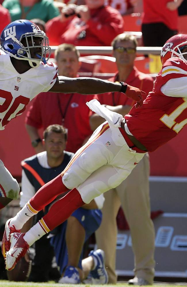 Kansas City Chiefs wide receiver Donnie Avery (17) dives for the ball while covered by New York Giants cornerback Prince Amukamara (20) during the second half of an NFL football game at Arrowhead Stadium in Kansas City, Mo., Sunday, Sept. 29, 2013. The pass was incomplete