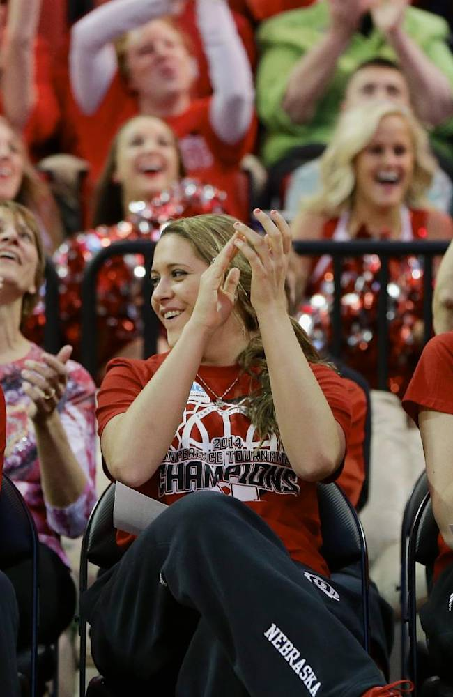 CORRECT ROUND THEY WILL PLAY IN THE TOURNAMENT - Nebraska's Jordan Hooper, left, Hailie Sample, center, and Emily Cady, right, react after they hear their assignment for the NCAA college basketball tournament during a live television broadcast in Lincoln, Neb., Monday, March 17, 2014. Nebraska will play in the first round against Fresno State in Los Angeles