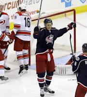 Columbus Blue Jackets' Artem Anisimov, of Russia, and Nathan Horton (8) celebrate Anisimov's goal against the Carolina Hurricanes during the third period of an NHL hockey game in Raleigh, N.C., Saturday, March 29, 2014. Columbus won 3-2 in overtime. (AP Photo/Gerry Broome)
