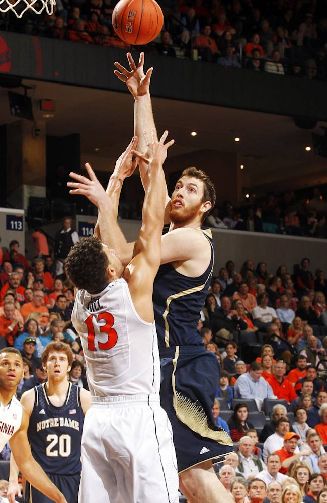 Notre Dame center Garrick Sherman, right, shoots over Anthony Gill during an NCAA college basketball game Saturday, Feb. 22, 2014, in Charlottesville, Va