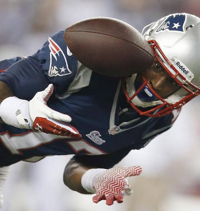 New England Patriots wide receiver Aaron Dobson can't make the reception on a pass from Tom Brady during the second quarter of an NFL football game against the New York Jets on Thursday, Sept. 12, 2013, in Foxborough, Mass