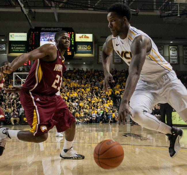 VCU forward Juvonte Reddic, right, drives along the baseline defended by Winthrop forward Larry Browne, left, during the second half of an NCAA college basketball game in Richmond, Va., Saturday, Nov. 16, 2013. VCU won 92-71
