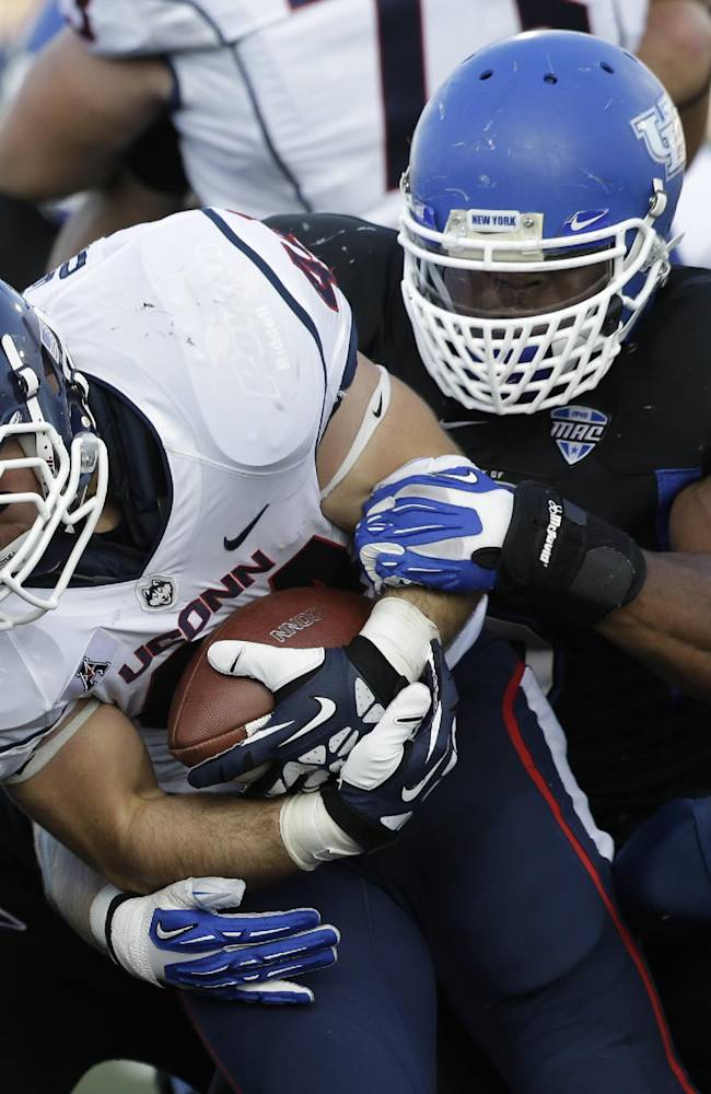 In this Sept. 28, 2013 file photo, Buffalo linebacker Khalil Mack, right, tackles Connecticut running back Max DeLorenzo (44) during the second half of an NCAA college football game in Buffalo, N.Y. Buffalo has won seven consecutive games this season.  The Bulls defense is led by star senior linebacker Khalil Mack, who has been named a semifinalist for both the Butkus and Bednarik Awards, which go to the nation's top linebacker and defensive player
