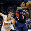 Atlanta Hawks' Louis Williams (3) loses the ball as Phoenix Suns' Goran Dragic, of Slovenia, reaches in during the first half of an NBA basketball game, Sunday, March 2, 2014, in Phoenix The Associated Press
