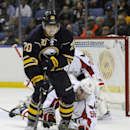 Buffalo Sabres center Zac Dalpe (20) chases a rebound as Washington Capitals defenseman Patrick Wey (56) defends during the first period of an NHL hockey preseason game, Wednesday, Oct., 1, 2014, in Buffalo, N.Y. (AP Photo/Gary Wiepert)