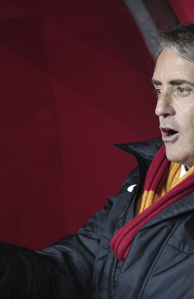 Galatasaray's manager Roberto Mancini reacts during their UEFA Champions League Round of 16, First Leg match against Chelsea at Turk Telekom Arena Stadium in Istanbul, Turkey, Wednesday, Feb. 26, 2014