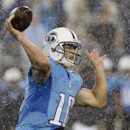 Tennessee Titans quarterback Jake Locker passes against the Green Bay Packers in the rain during the first quarter of a preseason NFL football game Saturday, Aug. 9, 2014, in Nashville, Tenn The Associated Press