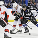 Tampa Bay Lightning right wing Ryan Callahan (24) battles with Ottawa Senators left wing Clarke MacArthur (16) for the puck in front of Senators' Chris Phillips (4) during the second period of an NHL hockey game Saturday, Nov. 29, 2014, in Tampa, Fla The