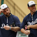 Detroit Tigers pitchers Joba Chamberlain, left, and Joe Nathan wait to take part in a fielding drill before an exhibition spring training baseball game between the Tigers and the Pittsburgh Pirates in Lakeland, Fla., Tuesday, March 4, 2014 The Associated