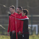 Manchester United's Robin van Persie, centre, trains with teammates including Shinji Kagawa, right, and Jonny Evans at Carrington training ground in Manchester, Monday, Dec. 9, 2013. Manchester United will at Shakhtar Donetsk in a Champion's League Group