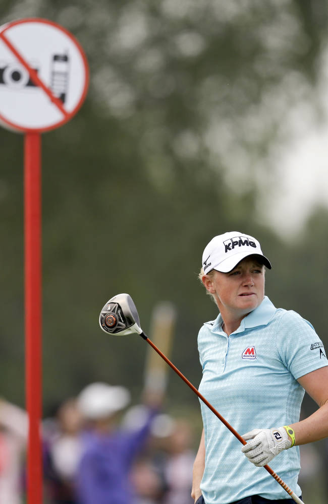 Stacy Lewis of the United States follows her ball after teeing off on the forth hole during the final round of the Reignwood LPGA Classic golf tournament at Pine Valley Golf Club on the outskirts of Beijing, China, Sunday, Oct. 6, 2013