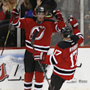 New Jersey Devils' Ryan Carter (20) and Michael Ryder (17) celebrate a goal by Carter against the Washington Capitals during the third period of an NHL hockey game, Friday, April 4, 2014, in Newark, N.J. The Devils won 2-1 The Associated Press