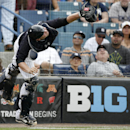 New York Yankees catcher Brian McCann reaches to catch Toronto Blue Jays' Edwin Encarnacion's pop fly-out in foul territory behind the plate in the sixth inning during a spring exhibition baseball game in Tampa, Fla., Sunday, March 23, 2014 The Associate