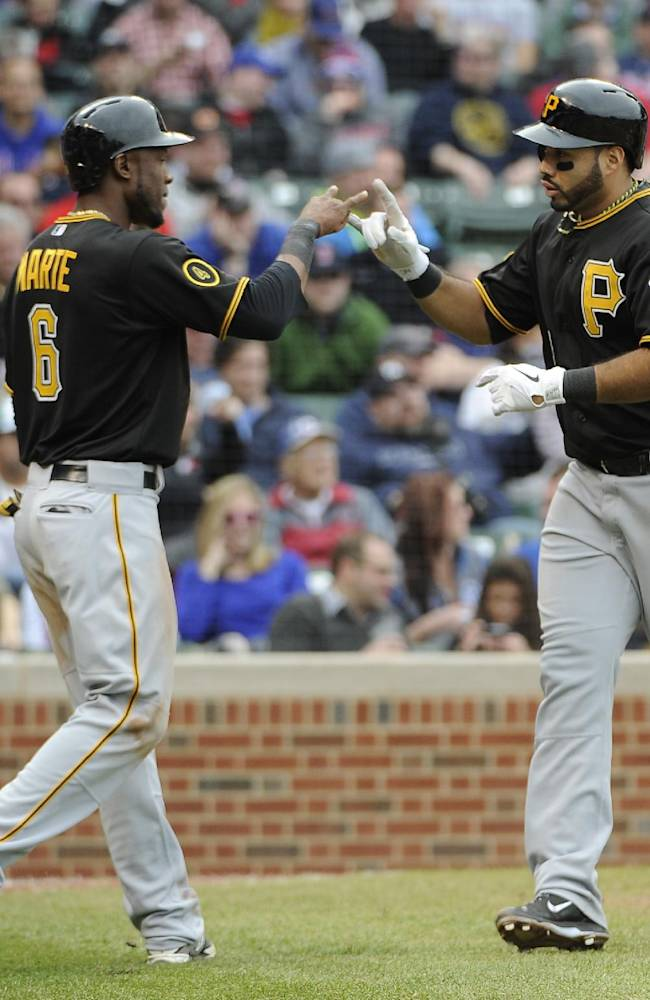 Pittsburgh Pirates' Pedro Alvarez, right, is greeted by Starling Marte (6) after hitting a three-run home run against the Chicago Cubs during the seventh inning of a baseball game on Thursday, April 10, 2014, in Chicago