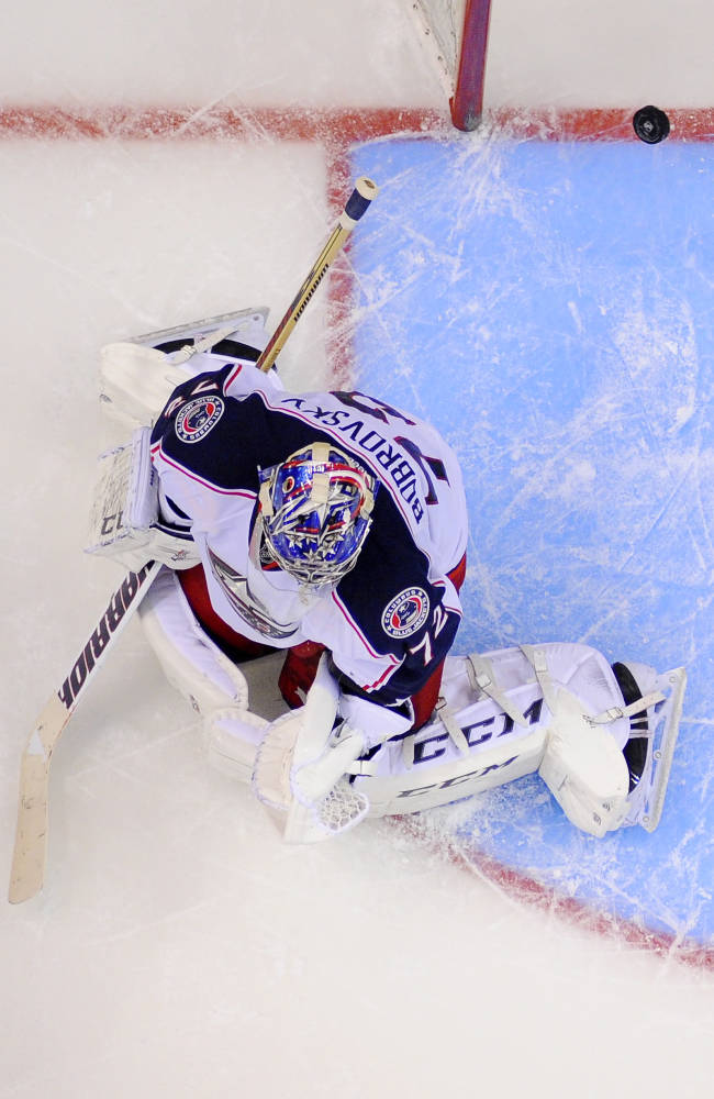 Columbus Blue Jackets goalie Sergei Bobrovsky, of Russia, is scored on by Los Angeles Kings defenseman Robyn Regehr, of Brazil, during the overtime period of an NHL hockey game, Thursday, Feb. 6, 2014, in Los Angeles