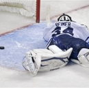 Toronto Maple Leafs goalie James Reimer lays on the ice after getting beat on the game winning goal by Boston Bruins center P