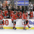 The Chicago Blackhawks' celebrate their second goal of the game, scored by Patrick Kane, right, during the first period of an NHL hockey game against the Philadelphia Flyers Tuesday, Oct. 21, 2014, in Chicago The Associated Press