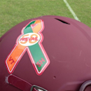 A ribbon-shaped decal is shown on a Virginia Tech helmet at NCAA college football practice, Wednesday, Dec. 26, 2012, in Orlando, Fla. The Hokies are wearing the decal that includes the number 58, a nod to the 32 murdered by a gunman at the university in 2007 and the 26 murdered in Newtown, Conn., this month. The Hokies take on Rutgers in the the Russell Athletic Bowl on Friday. (AP Photo/Kyle Hightower)