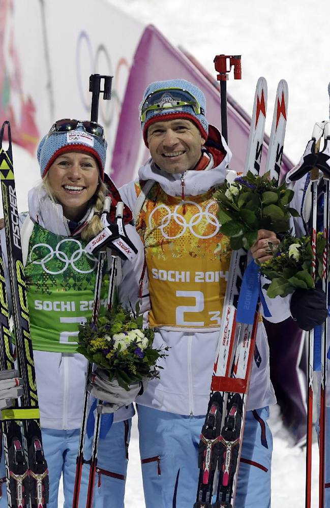 From left, Norway's Tora Berger, Tiril Eckhoff, Ole Einar Bjoerndalen and Emil Hegle Svendsen celebrate their gold medal in the mixed biathlon relay at the 2014 Winter Olympics, Wednesday, Feb. 19, 2014, in Krasnaya Polyana, Russia