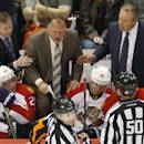 Florida Panthers assistant coaches John Madden, back left, and Mike Kelly, back right, restrain head coach Gerard Gallant as he yells at officials after Colorado Avalanche scored two, power-play goals in the second period of an NHL hockey game in Denver on Tuesday, Oct. 21, 2014. (AP Photo/David Zalubowski)
