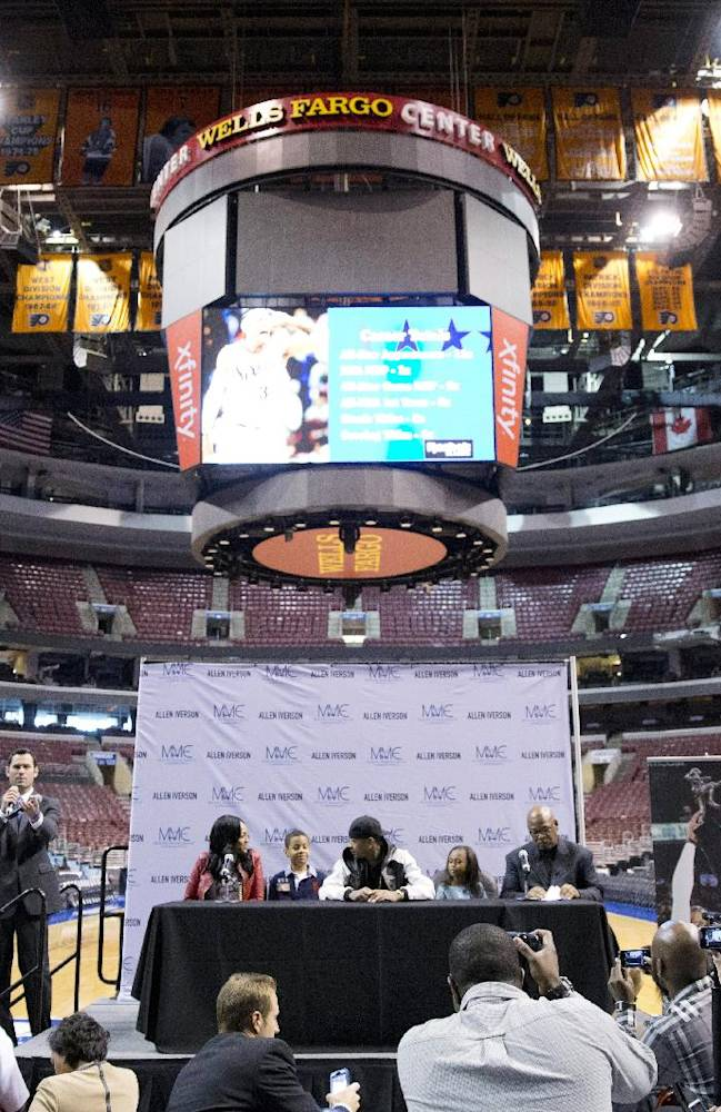 Former Philadelphia 76er Allen Iverson, accompanied by his daughter Tiaura, 18, left, son Isaiah, 7, and daughter Messiah, 10, second from right, speaks at a news conference Wednesday, Oct. 30, 2013, in Philadelphia. Iverson officially retired from the NBA, ending a 15-year career during which he won the 2001 MVP award and four scoring titles. Iverson retired in Philadelphia where he had his greatest successes and led the franchise to the 2001 NBA finals