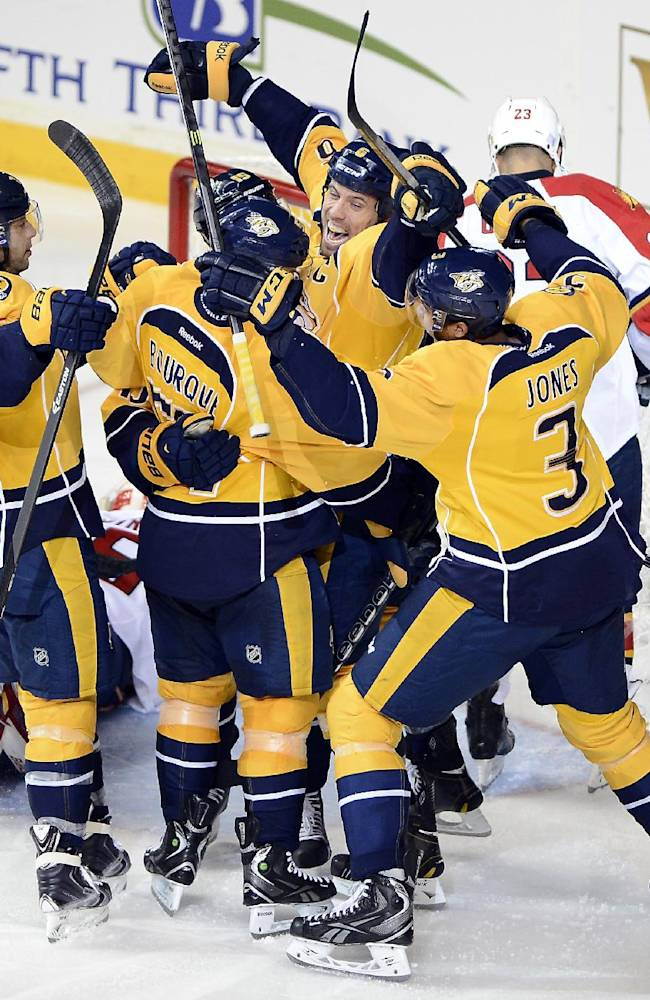 Nashville Predators defenseman Shea Weber, second from right, celebrates after his teammate forward Craig Smith scored a goal against the Florida Panthers in the third period of an NHL hockey game on Tuesday, Oct. 15, 2013, in Nashville, Tenn. Nashville Predators won 4-3