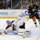 Phoenix Coyotes goalie Jason LaBarbera, left, blocks a shot by Anaheim Ducks right wing Teemu Selanne during the second perio