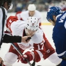 Detroit Red Wings' Daniel Cleary (17) eyes the puck during a face-off against Toronto Maple Leafs' Daniel Winnik during third-period preseason NHL hockey game action in Toronto, Friday, Oct. 3, 2014 The Associated Press