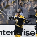 Boston Bruins' Brad Marchand celebrates his goal beside teammate Dougie Hamilton (27) during overtime in an NHL hockey game against the Florida Panthers in Boston, Tuesday, Nov. 4, 2014. The Bruins won 2-1 The Associated Press