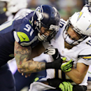 Seattle Seahawks defensive end Cassius Marsh (91) puts a hit on San Diego Chargers quarterback Kellen Clemens after Clemens got the ball off in the first half of a preseason NFL football game, Friday, Aug. 15, 2014, in Seattle The Associated Press