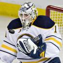 Buffalo Sabres goalie Jhonas Enroth makes a save against the Edmonton Oilers during the second period of an NHL hockey game Thursday, Jan. 29, 2015, in Edmonton, Alberta. (AP Photo/The Canadian Press, Jason Franson)