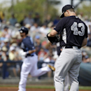 New York Yankees relief pitcher Adam Warren, right, stands by the mound as Tampa Bay Rays' Ben Zobrist, left, runs the bases after hitting a home run in the first inning of an exhibition baseball game, Wednesday, March 5, 2014, in Port Charlotte, Fla The