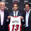 MIAMI, FL - JUNE 30: Pat Riley, Shabazz Napier #13 and Erik Spoelstra of the Miami Heat pose for a photo during a press conference at the American Airlines Arena in Miami, Florida. (Photo by Issac Baldizon/NBAE via Getty Images)