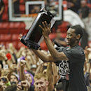 San Diego State 's Xavier Thames holds the conference trophy after State's 51-48 victory over New Mexico that captured the Mountain West Conference regular season championship in a NCAA college basketball game Saturday, March 8, 2014, in San Diego The As