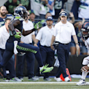 Seattle Seahawks strong safety Kam Chancellor, left, runs with the ball toward Denver Broncos center Manny Ramirez, right, after Chancellor intercepted a pass during the second half of an NFL football game, Sunday, Sept. 21, 2014, in Seattle The Associate