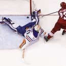 Edmonton Oilers goalie Ben Scrivens, left, makes a save on a shot by Phoenix Coyotes' Oliver Ekman-Larsson (23), of Sweden, during the shootout of an NHL hockey game, Friday, April 4, 2014, in Glendale, Ariz. The Oilers defeated the Coyotes in a shootout