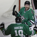 Dallas Stars center Rich Peverley (17) looks to teammate Shawn Horcoff (10) to celebrate after Peverley scored during the first period of an NHL hockey game against the Chicago Blackhawks on Friday, Nov. 29, 2013, in Dallas The Associated Press