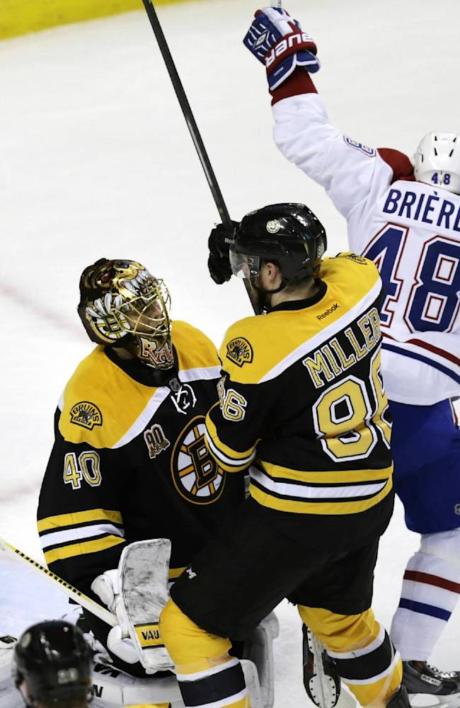 Montreal Canadiens center Daniel Briere (48) raises his arms after teammate P.K. Subban's goal off Boston Bruins goalie Tuukka Rask (40) during the first period of Game 1 in the second-round of the Stanley Cup playoff series in Boston, Thursday, May 1, 2014
