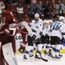 San Jose Sharks' Matt Nieto skates off the ice with teammates Brent Burns (88), Patrick Marleau (12), Mirco Mueller (41), Logan Couture (39) after Nieto scored a goal against Arizona Coyotes' Mike Smith, left, as Coyotes' Oliver Ekman-Larsson (23), of Swe