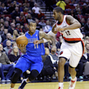 Dallas Mavericks guard Monta Ellis, left, drives to the basket against Portland Trail Blazers forward LaMarcus Aldridge during the first half of an NBA basketball game in Portland, Ore., Saturday, Dec. 7, 2013 The Associated Press