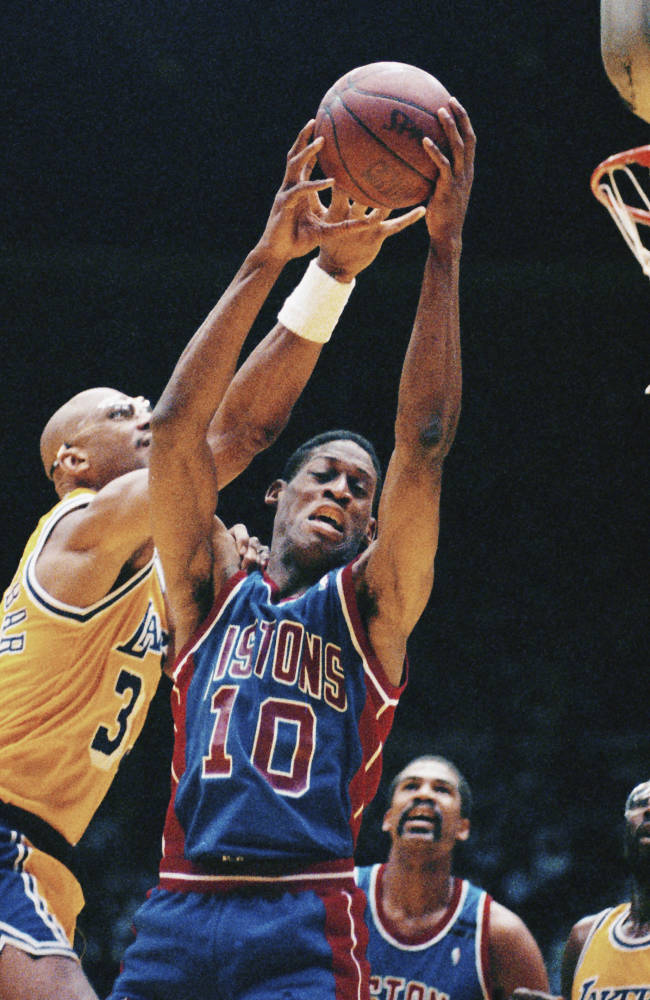 FILE - In this June 11, 1989, file photo, Detroit Pistons' Dennis Rodman (10) grabs a rebound away from Los Angeles Lakers' Kareem Abdul-Jabbar, left, during Game 3 of the NBA Finals in Los Angeles. Rematches aren't exactly rare in the NBA Finals, with the Warriors-Cavaliers series set to become the 14th in league history. Teams that lost one season and then got their rematch have managed to atone for the loss in seven of the previous 13 instances. (AP Photo/Bob Galbraith, File)