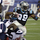 New England Patriots linebacker James Anderson, left, and defensive tackle Tommy Kelly, bottom, tackle Carolina Panthers running back Jonathan Stewart (28) in the first half of an NFL preseason football game Friday, Aug. 22, 2014, in Foxborough, Mass The