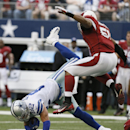 Dallas Cowboys tight end Jason Witten (82) goes down as Arizona Cardinals inside linebacker Kevin Minter (51) moves in during the first half of an NFL football game Sunday, Nov. 2, 2014, in Arlington, Texas The Associated Press