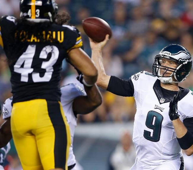 Philadelphia Eagles quarterback Nick Foles, right, passes during the first half of an NFL preseason football game against the Pittsburgh Steelers, Thursday, Aug. 21, 2014, in Philadelphia